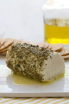 An easy appetizer for a holiday party: Roll a log of soft goat cheese in crushed peppercorns and Italian seasoning then drizzle with extra virgin olive oil. Guests will love the creamy, tangy, gentle heat and light crunch of this goat cheese dish.