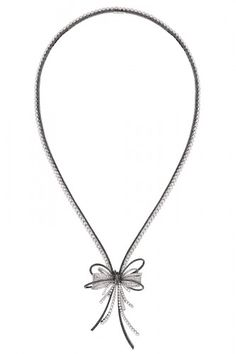 """""""Simplicity does not mean poverty.""""      Chanel Ruban Couture Necklace."""