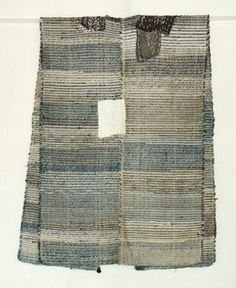 This is a vintage Japanese sakiori sodenashi (sleeveless ) which is hand-woven of cotton strips which are torn from old cloth, such as kimono, furoshiki, futon cover and so on. Warps are also cotton threads. It has beautiful mixed color of natural indigo and others. It has wear and mending patches and both sides are open. Late 19th to early 20th century.