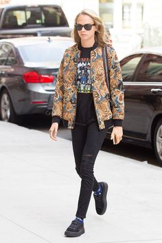 Cara Delevingne stepped out in a colourful graphic animal print bomber jacket and PUMA by Rihanna trainers after leaving a photo shoot in New York City.