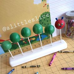 Very Hungry Caterpiller cake pops in a KC Bakes Skinny Mini Cake Pop Stand.