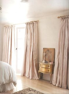Feminine dusky pink silk curtains. So dreamy.