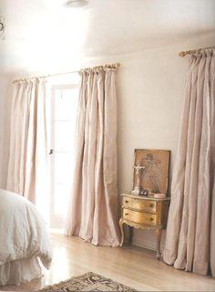 Feminine dusky pink silk curtains. So dreamy.