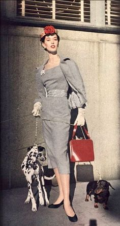 1953 Barbara Mullen in gray belted suit by Herbert Sondheim together with straw pillbox and red calfskin bag by Koret, photo by Frances McLaughlin-Gil!
