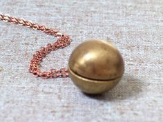 Vintage Brass and Copper Sphere Ball Locket by LoveLockets on Etsy, $18.00