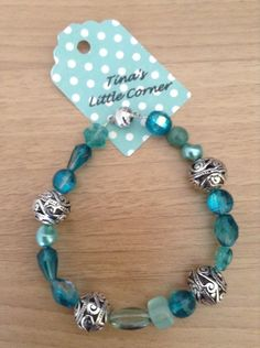 A personal favorite from my Etsy shop https://www.etsy.com/listing/294347969/teal-silver-bead-bracelet