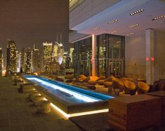 I know where i want to go for my next date night ... Press Lounge, New York City    The ground floor of Manhattan's Ink48 hotel houses an urbane restaurant called Print, serving farm-to-table fare. The top floor features the über-cool Press Lounge, with a glass-enclosed bar, an outdoor pool, and unobstructed views of the Hudson River—it's been drawing a fashionable crowd since the rooftop hot spot opened this spring.