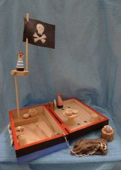 from craftster.org, another great project! A fold away peg doll pirate play kit.