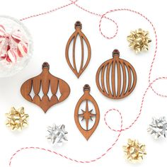 Our mid-century modern ornaments are timeless, sophisticated, and class up any Christmas tree. Makes a nice gift to any retro collector or vintage design enthusiast. • Set of four ornaments • Laser cu
