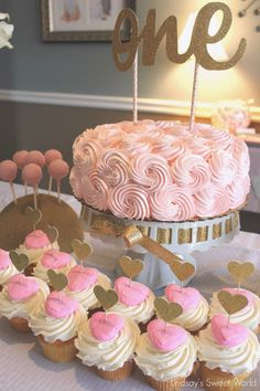 "Pink & Gold First Birthday: Beautiful cake and cupcakes. Love the ""one"" cake topper - would be cute for any age, too!"