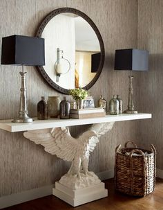 I am going to be on the lookout for a garden statue to use as a base to recreate this look in a console table.....k....this design by Thom Filicia