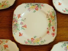 Set of 5 tea / side plates by Burleigh ware.  Back stamp Burleigh Beehive. Imperial shape but unusual realistic flower pattern for thie era of BW| eBay! Aug 2017. GBP5 BIN