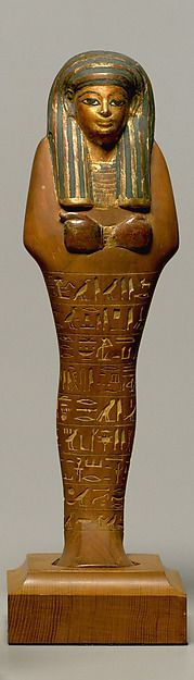 Shabti of Yuya.New Kingdom. Dynasty 18.reign of Amenhotep III,ca.1390–1352 B.C.Egypt. Tomb, KV 46, contained the burials of Yuya and Tjuyu, the father and mother of Queen Tiye, who was the principal wife of Amenhotep III. This funerary figurine was made by the finest craftsmen who served the royal court. It has been inscribed with the shabti text from the Book of the Dead, which ensures that shabti will take Yuya's place if he is required to perform agricultural  labor in the afterlife.