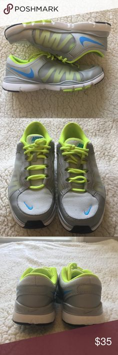 Nike Flex TR2 Shoes Like new Nike running shoes. Blue grey and neon yellow, worn only a couple times. Nike Shoes Athletic Shoes