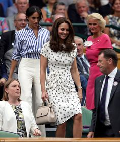 The Duchess of Sussex and Duchess of Cambridge taking their seats on Wimbledon's Centre Co...