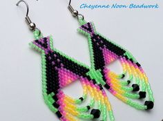 These brick-stitch earrings are made with Delica seed beads in luminous neons and coordinating colors, and hoop fringes featuring faceted black crystal bicones. They measure 1 1/4 at the widest point and hang 3 down from stainless steel ear wires. This item is in stock and ready to ship. Every item in my shop is individually designed and handcrafted by an enrolled tribal member of the Cheyenne and Arapaho Tribes of Oklahoma. Thank you for looking and please check out my shop for other ...