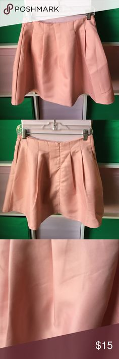 Princess a line pale pink skirt Feel just like a princess in this skirt. I only wore it once to Disney Paris. Says Large but fits small/medium. My waist is a 27. Has perfect lining. No flaws or imperfections Skirts Mini