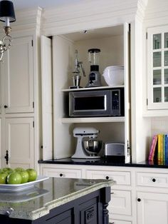 hide the microwave, toaster, appliances, but make them all very accessible!!! Great idea.
