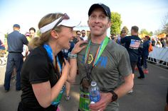 Description of . Kathryn Harter 3 mos. pregnant, congratulates her brother Pat Sullivan who captured the Full Marathon men's division in the 9th annual Colfax Marathon May 18, 2014. The 26.2 mile Marathon runs through Denver's iconic landmark Mile High Stadium (twice), Sloan's Lake, City Park, Colfax Avenue through Lakewood and Aurora. The Marathon started and finished in City Park where runners enjoyed the rest of the day listening to music by Chris Daniels and the Kings. (Photo by John ...