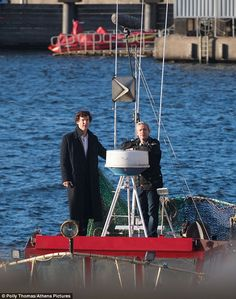 A-boat time: Benedict Cumberbatch and Martin Freeman were spotted filming for season 4 of Sherlock on a fishing boat in Cardiff, Wales on Wednesday