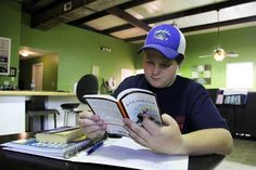 Cody Beck reads a book that was assigned by his teacher at Grenada Middle…