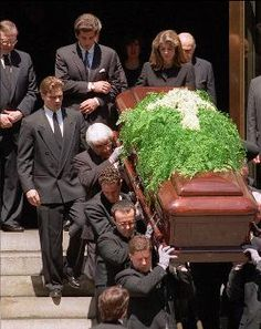 John Jr. and Caroline follow their mother's casket as it is carried out of St. Ignatius Loyola Catholic Church following a funeral Mass in New York. Jackie died May 19, 1994 at age 64.