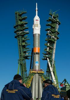 The gantry arms are raised around the Soyuz MS-02 spacecraft after it was raised into a vertical position on the launch pad, Sunday, Oct. 16, 2016 at the Baikonur Cosmodrome in Kazakhstan.