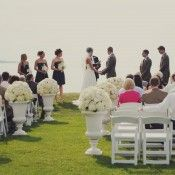 Outdoor Waterfront Wedding Ceremony - love the urns!