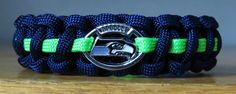 Handmade Seattle Seahawks Paracord Bracelet w/Alloy Buckle and Licensed Charm.  $12.75