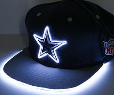 Turn heads as you show your favorite team some love by wearing a light up sports hat. These custom made hats comes in a variety of color schemes/team styles and feature bright neon trimming that outline the logo so it's visible to everyone in the room. Baby Cowboy Hat, Cowboy Hats, Light Up Hats, Neon Accessories, Custom Made Hats, Steampunk Top Hat, Led Projects, Rain Hat, Color Changing Lights