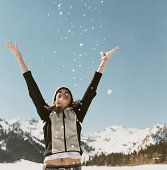 YOUNG WOMAN THROWING SNOW - WINTER FUN SQUAW VALLEY, CA PHOTO @ ANNE-MARIE WEBER