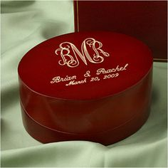 WeddingDepot.com ~ Ring Bearer Box - Rosewood Pillow Box ~ Your guests will admire the true beauty of this oval rosewood box as a unique presentation of your rings. Lifting of the lid displays a soft cream suede interior with a removable pillow insert.