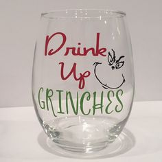 Fun Drink Up Grinches Wine Glass for the Holidays! *HOW LARGE ARE THE GLASSES? Wine glass holds 21 ounces of wine. *HOW SHOULD I WASH MY GLASS? HAND WASH ONLY! Glasses should NOT be soaked or scrubbed. Not dishwasher or microwave safe. *We use high quality permanent outdoor vinyl that is made to last years when properly cared for. *WHEN WILL MY ORDER SHIP? Processing time is currently 1-2 business days. SPOKANE AREA ORDERS: Enter coupon code SPOKANEPICKUP to remove the shipping fee. We c...