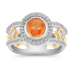 You can't get much more unique than this orange sapphire and diamond ring with white and yellow gold.