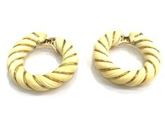 A vintage Van Cleef and Arpels gold/ivory hoops earring