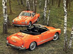 I have no idea what these cars are, but, they're shiny and orange and vintage and I want them.