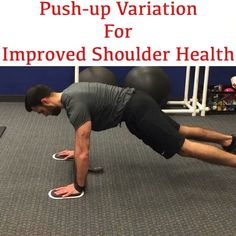 Push-ups with band around wrists hands on sliders. - Coaching Cues  1. Keep slight tension on the band without letting the sliders move 2. Should feel in the posterior shoulder and pressing muscles  3. Keep core and trunk braced entire time - #shoulderworkout #shoulderhealth #baseball #baseballtraining #pushup #upperbodyworkout #core #abs #rotatorcuff