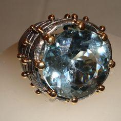 Topazio azzurro oro argento brunito.