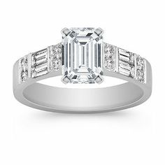 This beautiful cathedral engagement ring is part of our Legacy collection. Four channel set baguette diamonds, at approximately .42 carat TW, and eight round diamonds, at approximately .18 carat TW, are hand-matched and set in quality 14 karat white gold. The center diamond of your choice will be beautifully accented in this classic design. The total gem weight is approximately .60 carat. Shown with a center stone Emerald Cut Diamond.