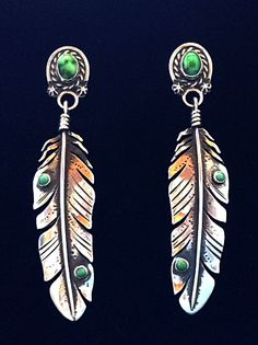 Feather earrings set with carico lake turquoise by Annelise Williamson.