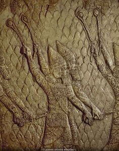 Assyrian slingers attacking the Judean fortified town of Lachish (battle 701 BCE). Part of a relief from the palace of Sennacherib at Niniveh, Mesopotamia (Iraq)