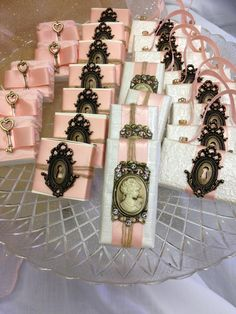 Antique silhouette broaches and locks compliment the pink and white wrappings on these SoBelle Chocolate Favors. They are perfect for a tea party, bridal shower or wedding!