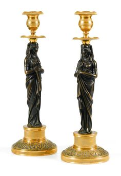 Pair of Egyptian candlesticks in patinated and gilded bronze, Berlin work circa 1800 attributed to Werner & Mieth.