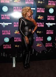 Black Shiny Lycra Asymmetric Catsuit worn By Mary J. Blige. Click Here To Buy your Catsuits from DCUK.