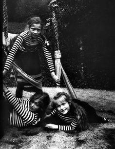 Grand Duchesses Tatiana, Maria, and Anastasia playing on some swings: 1907