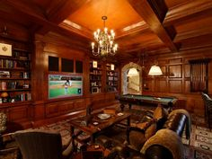 One of the two libraries is wood-paneled and features a 71-inch TV.