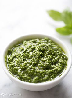 Classic, simple basil pesto recipe with fresh basil leaves, pine nuts, garlic, Romano or Parmesan cheese, extra virgin olive oil, and salt and pepper. ~ SimplyRecipes.com