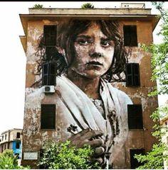 Street Art by Guido van Helten, located in Rome