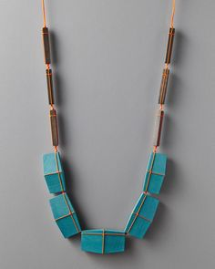 "Julia Turner ""Blue Gift"" necklace, 2014. Maple, stain, cord. 20 x 1 x 2/5 in (53 cm x 3 cm x 1 cm). Photo by Daniel Dent."