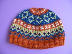 Knitting a Fair Isle Hat - One day I'll give it a try. Never knitted with so many colors at once.